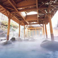 Get some R&R with a soak in the onsen at Hotel Okada