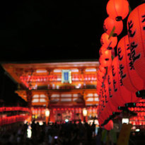 See the Red Gates Lit up by Lanterns at Fushimi Inari in Kyoto